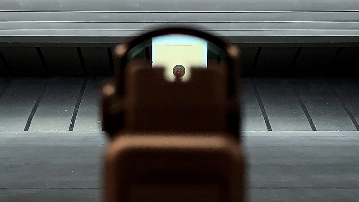While these tall, suppressor-height iron sights do allow a co-witness of sorts, they essentially block the red dot.