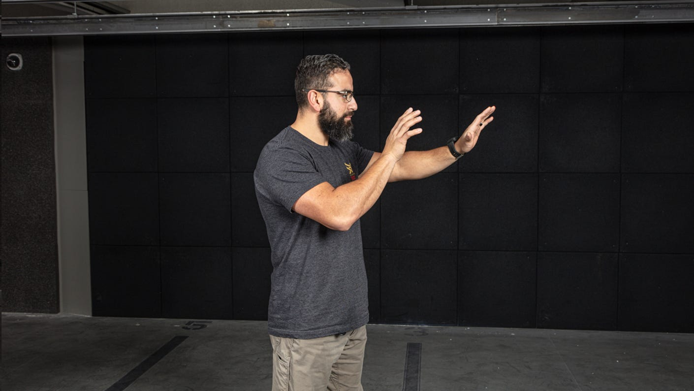 Dry fire stance with hands held out in front of your chest.