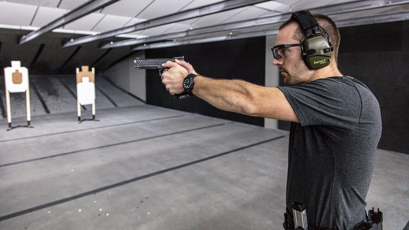 Action pistol indoor range training.