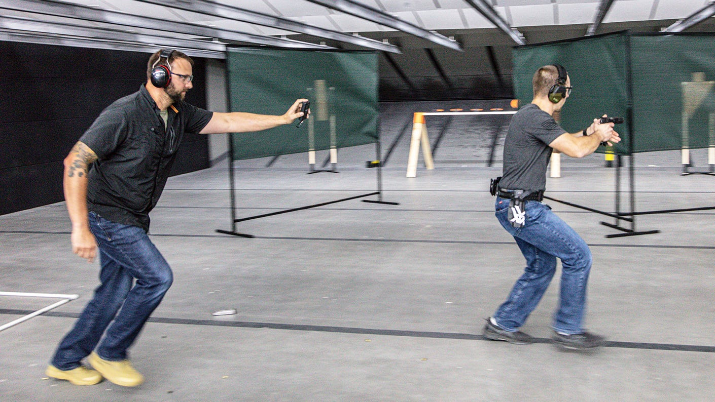 Indoor action pistol training with instructor.